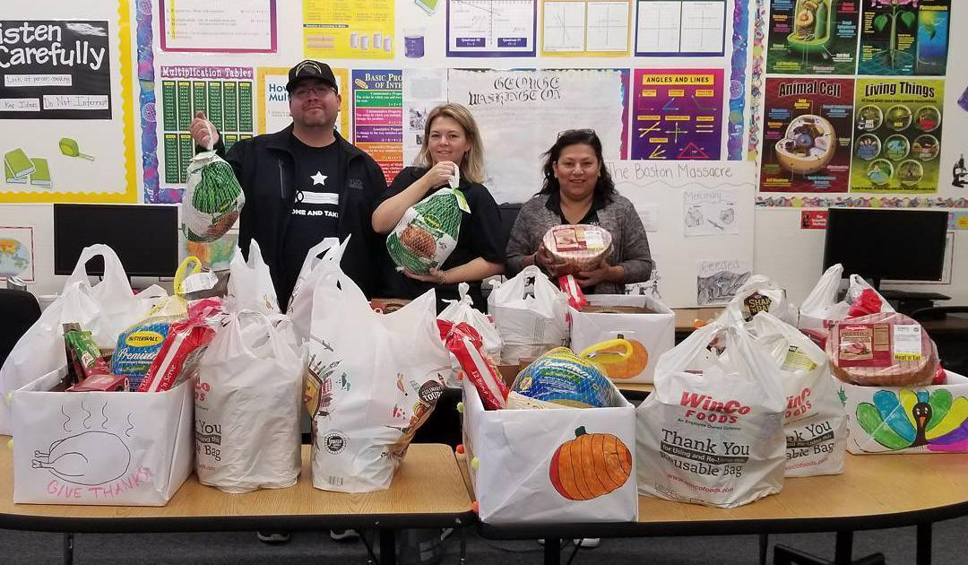 Nolan and Staff with donations from the community for Thanksgiving Dinner
