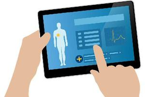 Hands entering health info on a tablet