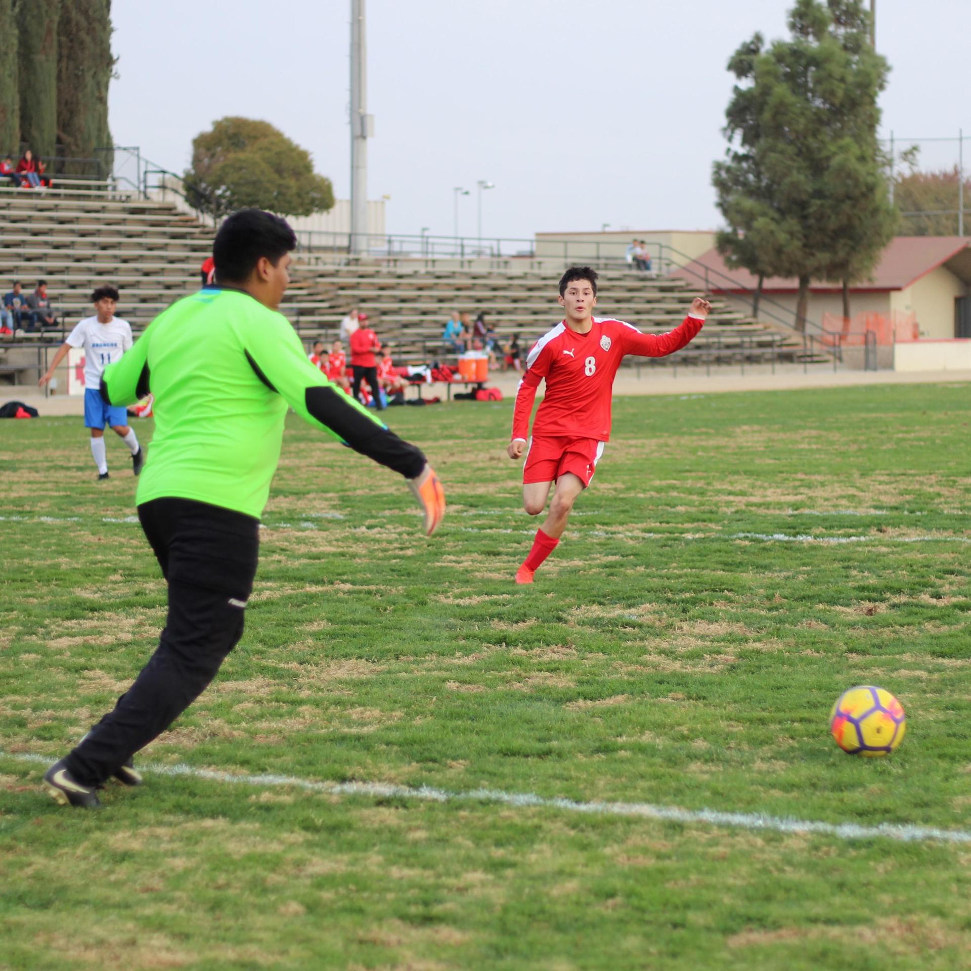 Francisco Chavez Running to Attack the Ball