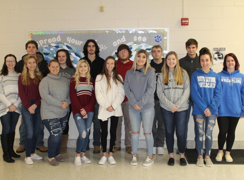 Students in a group photo in the hallway