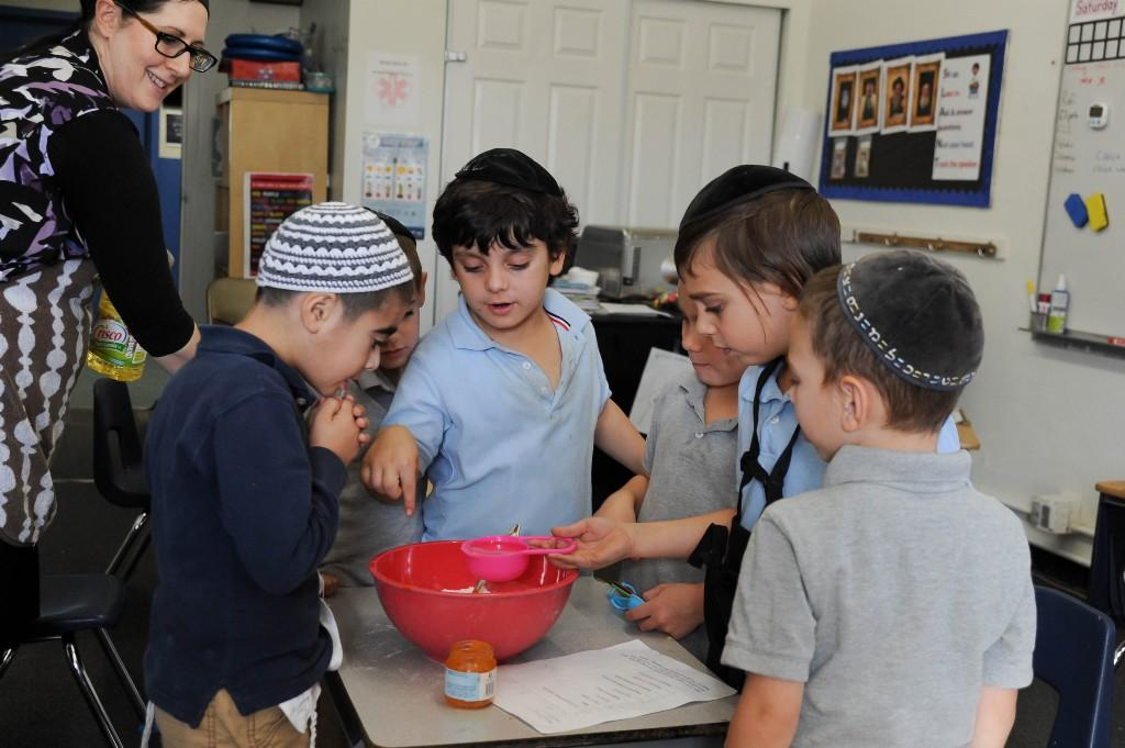 1st grade boys following a recipe together