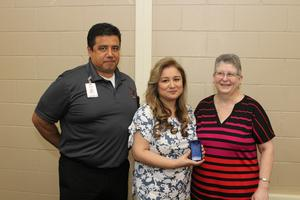 Diana Basurto with Manor Middle School Principal Don Wise and PEIMS Coordinator Anne Jones.
