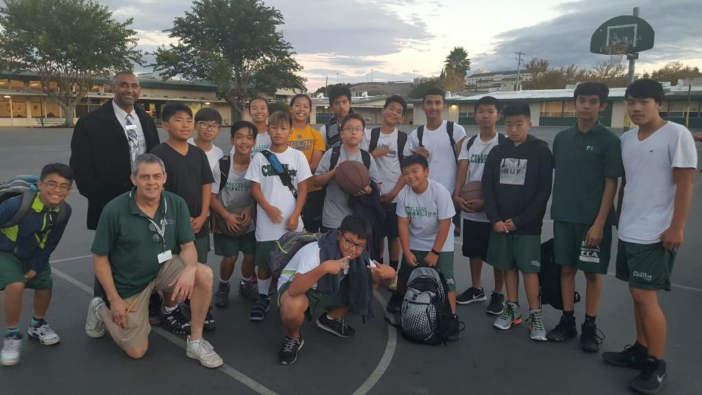 Students posing for photo during basketball.