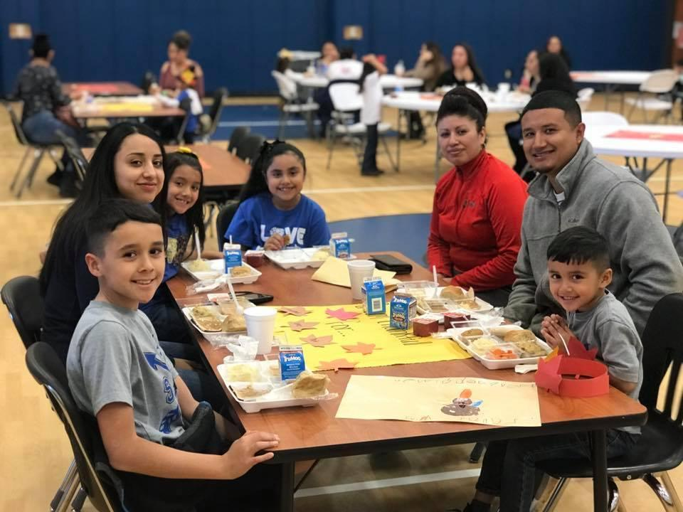 Family enjoying Thanksgiving luncheon