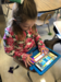 student coding on an iPad