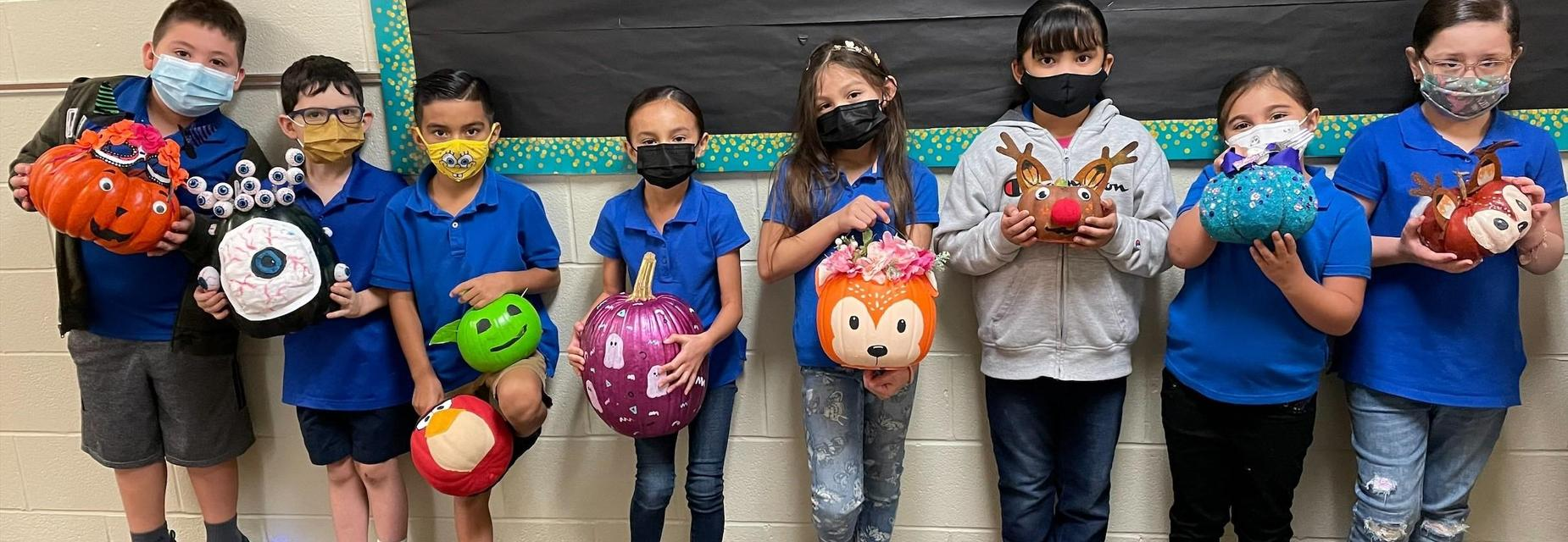 2nd graders with pumpkin characters