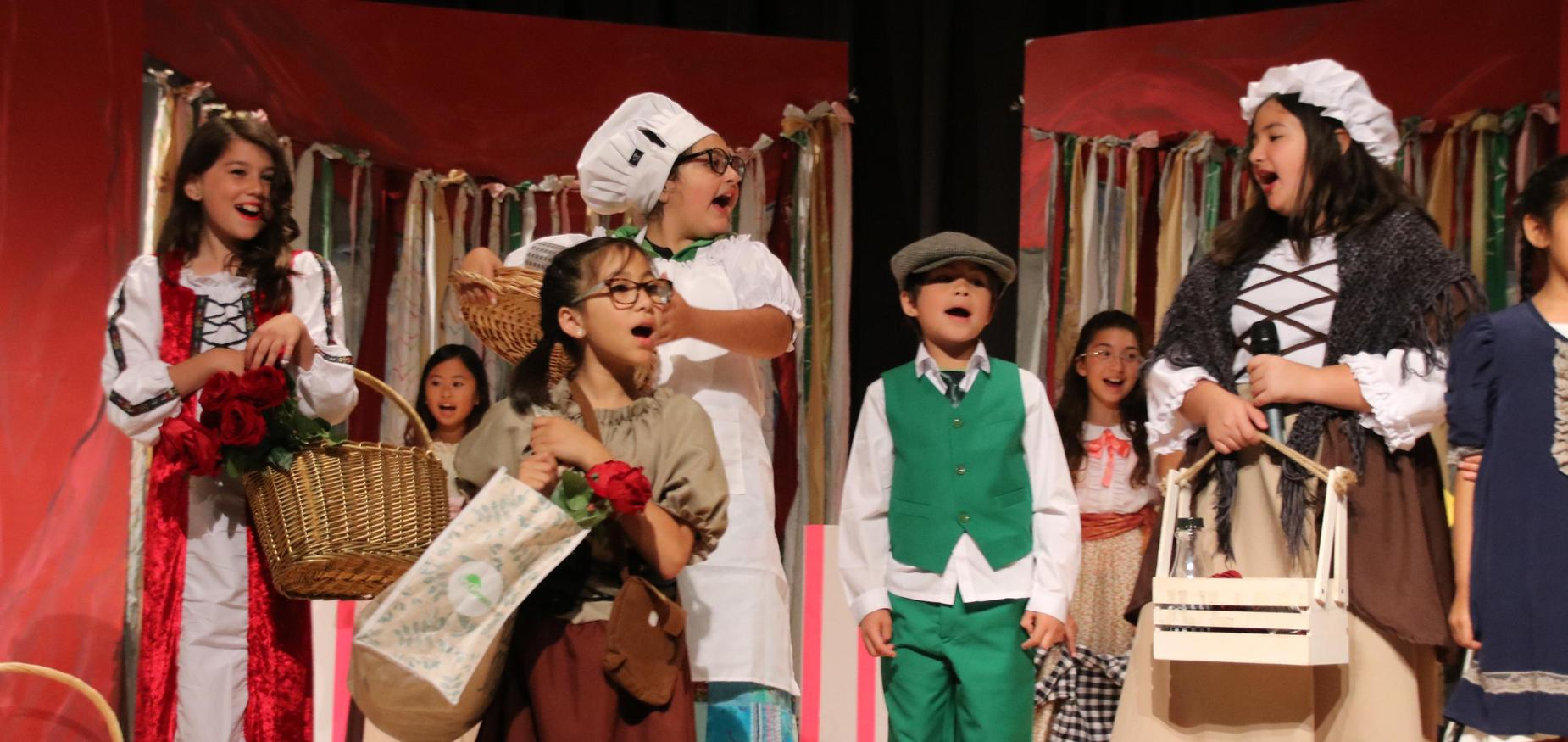 Students singing in the Adventures of Pinocchio