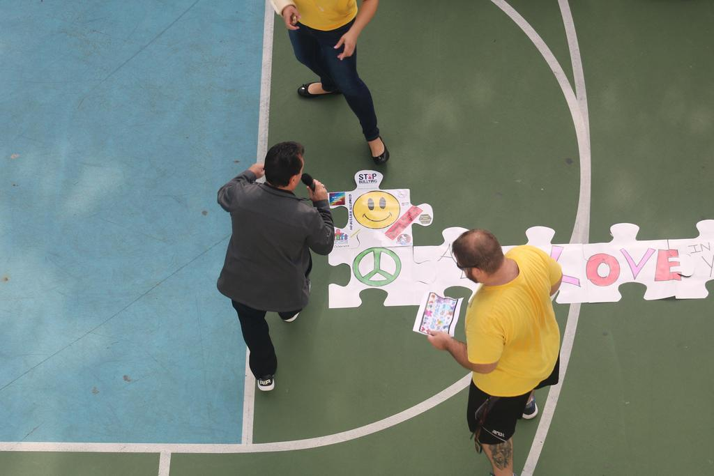 """Mr. celebrano & mr. blake putting together the puzzle piece first pieces of """"we believe in love"""""""