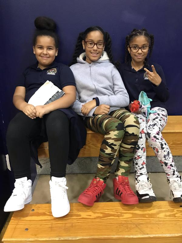 girls showing the peace sign for respect