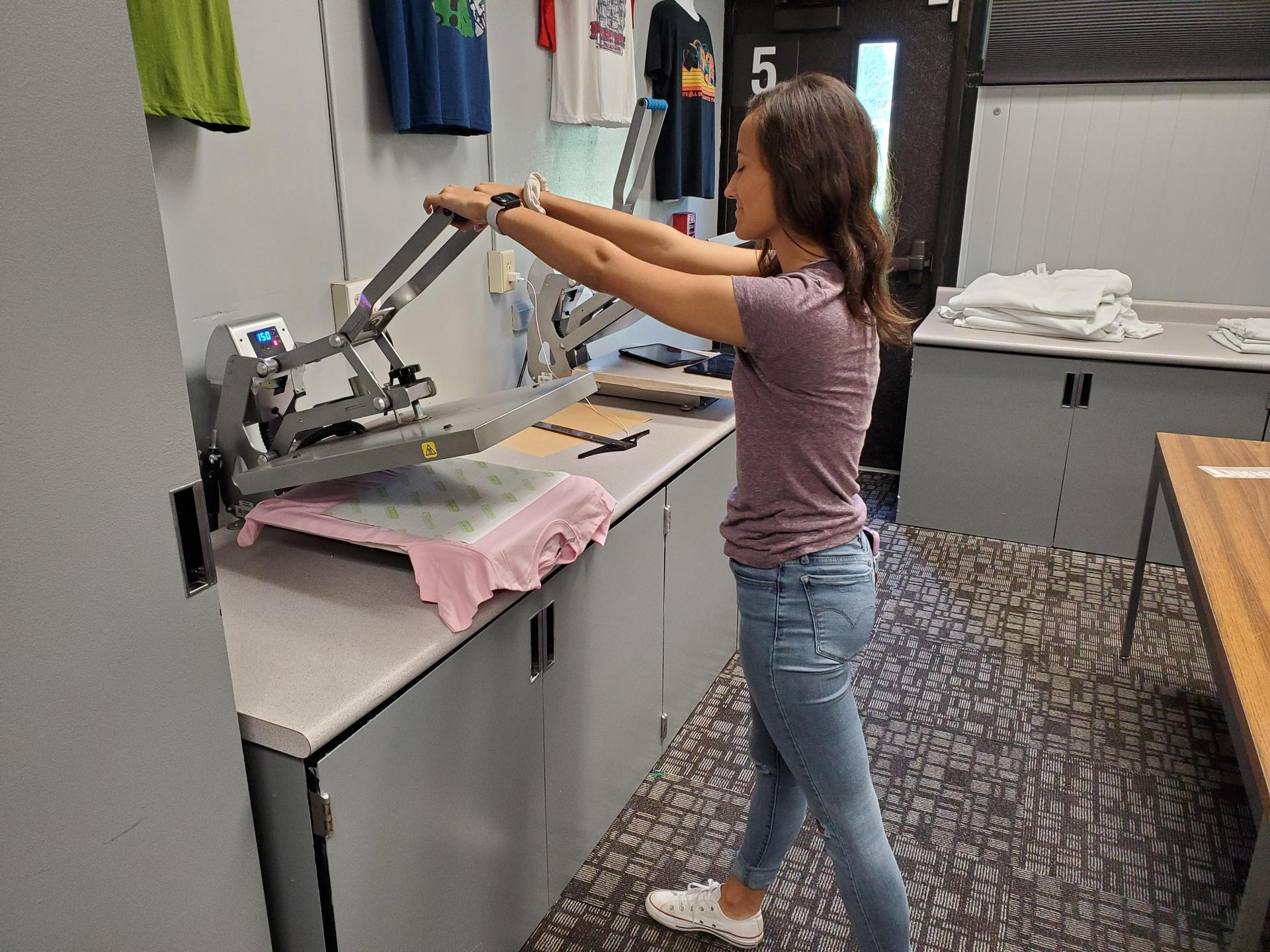 student pressing shirt