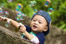 kid playing with bubbles