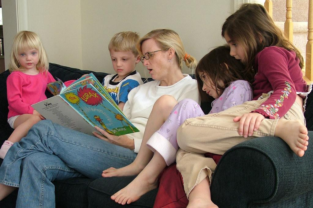 Parent is reading to children.