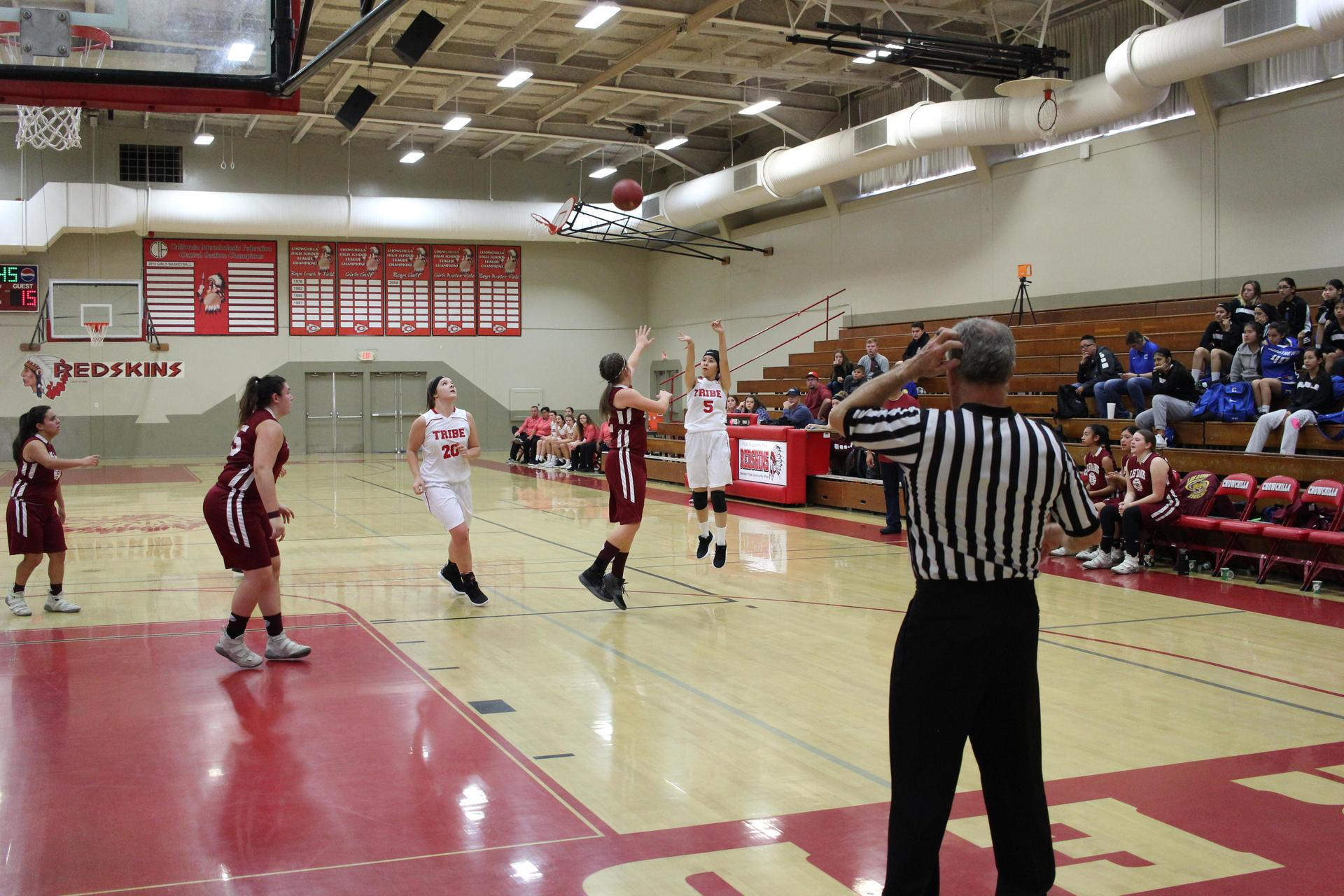 Junior Varsity girls playing basketball against Los Banos