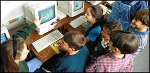 Children in classroom around computers