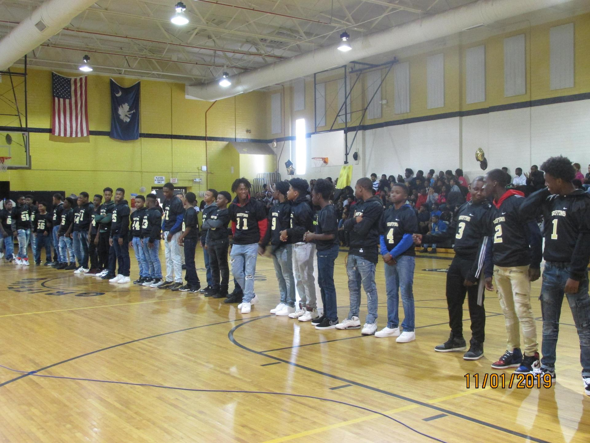 Football Team in the Gym at Pep Rally