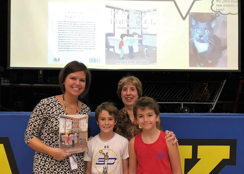 From left, Franklin School librarian/media specialist Rachel Kennedy welcomes former Westfield teacher, now a children's author, Angela LaCarrubba on Oct. 7.  LaCarrubba is pictured here with her grandsons, fifth grader Kyle LaCarrubba (center) and second grader Kellen LaCarrubba.