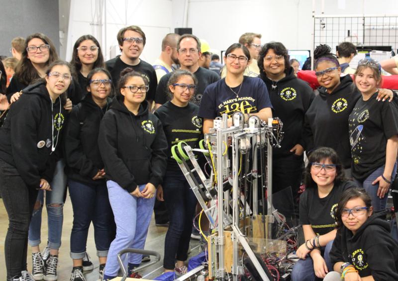 All girls robotics team with robot