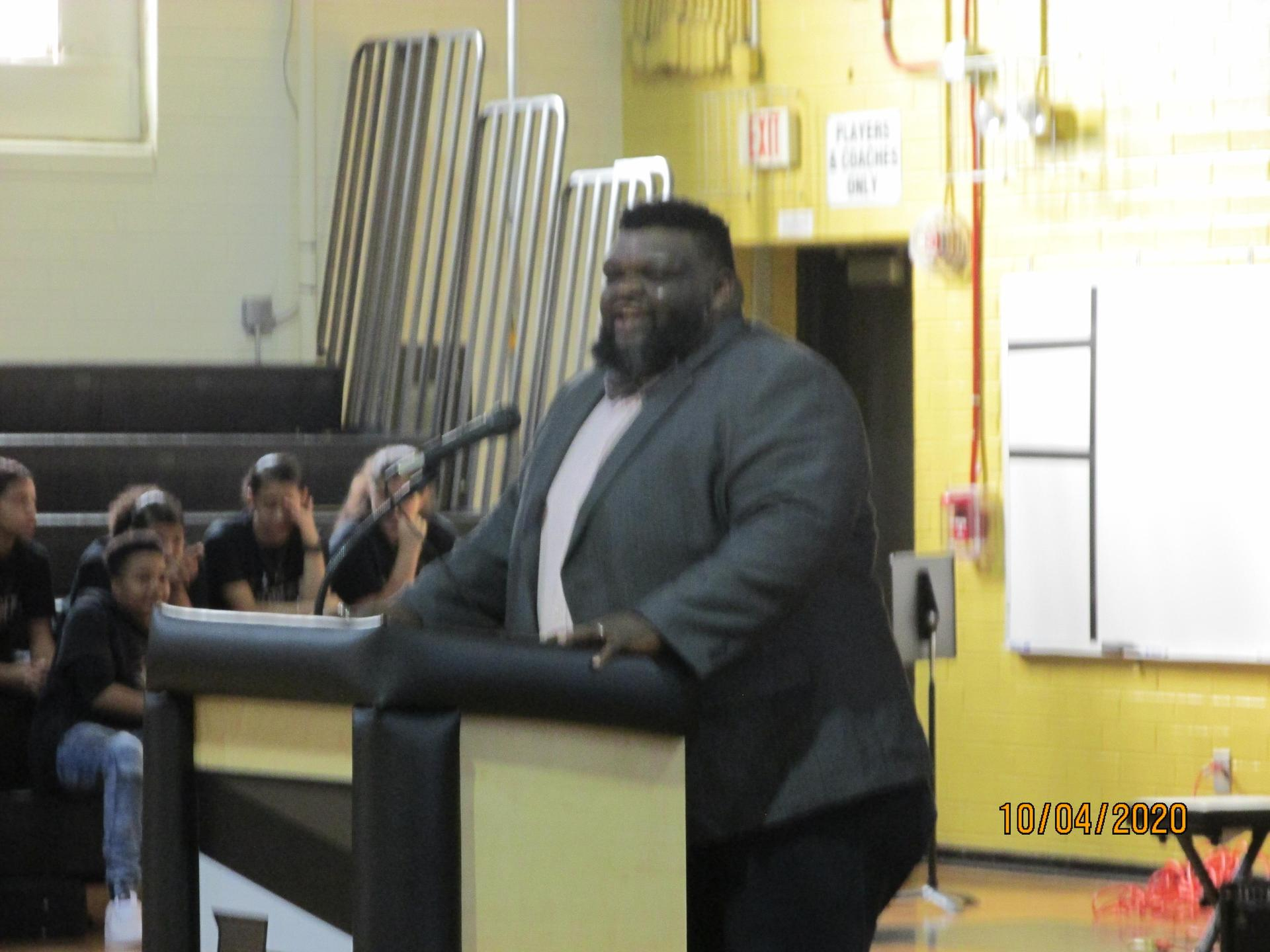 Mr. Brunson, Principal, at the microphone