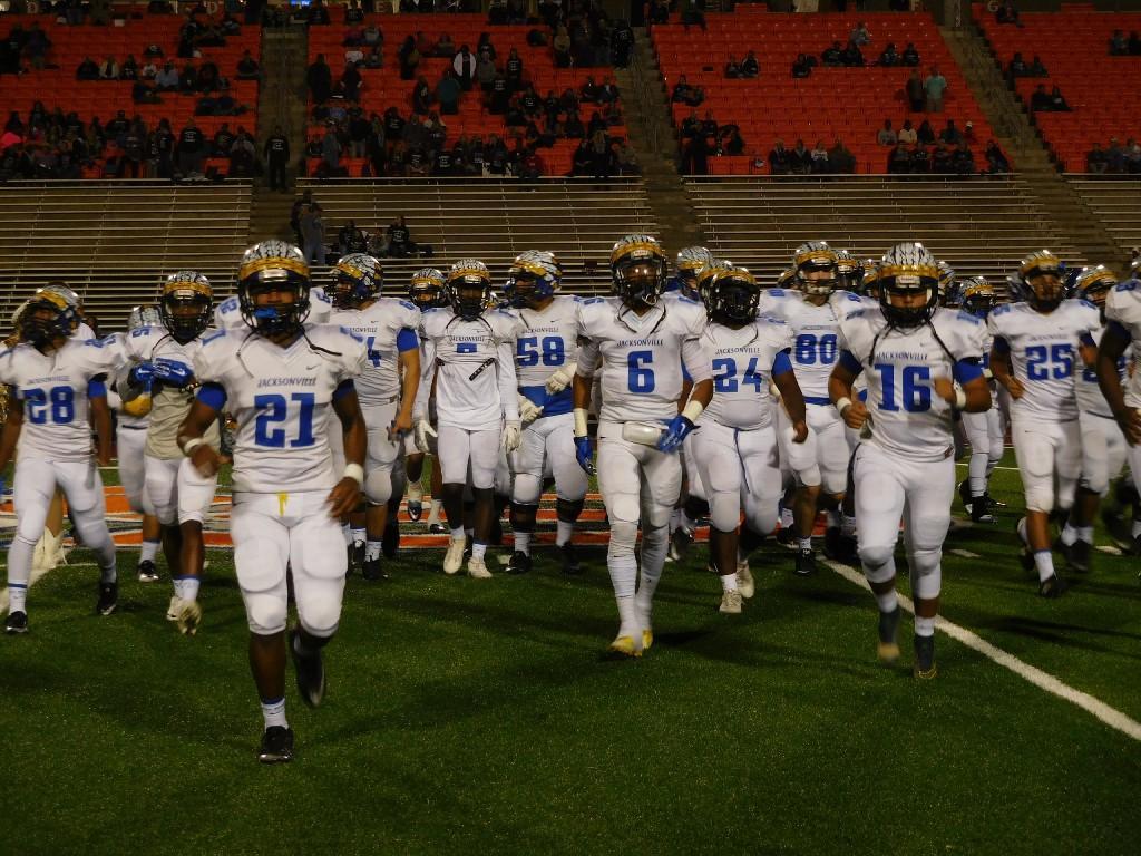 boys football team on field