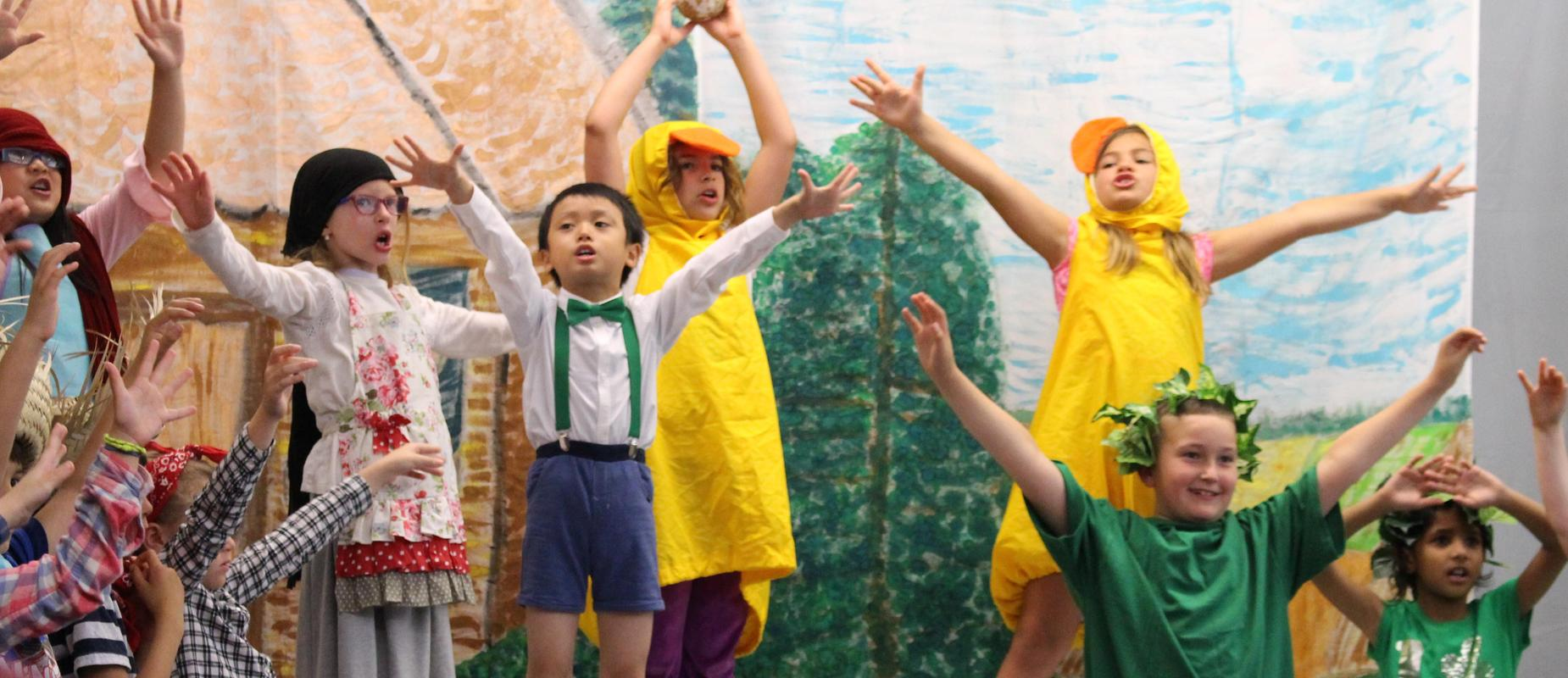 first graders perform Jack in the Beanstalk play with sky background