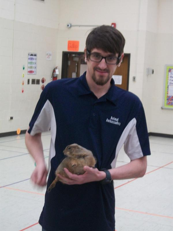 Handler holds Prairie Dog.