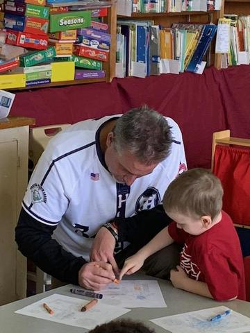Hi-Toms coach works with a student.