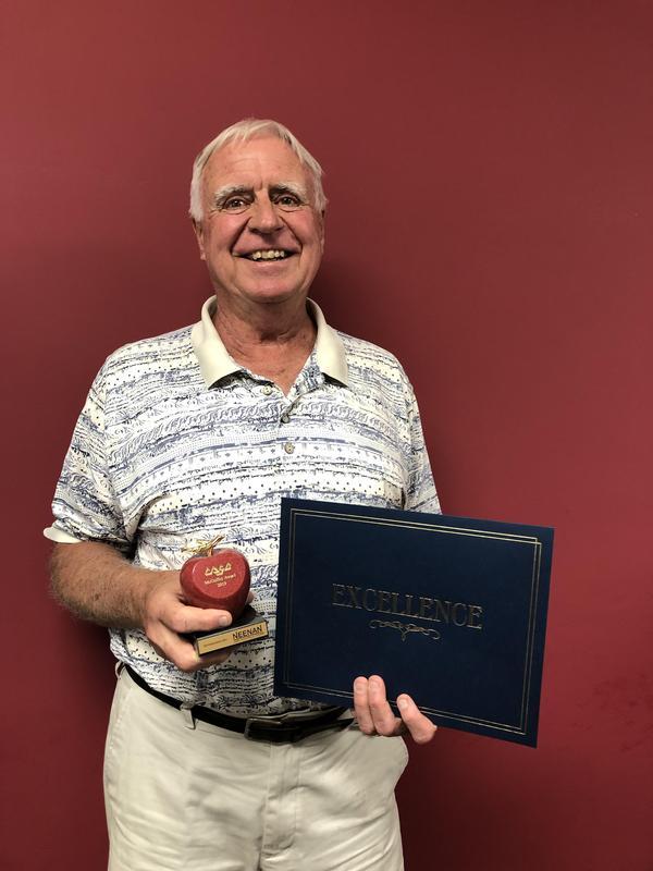 school board president holding award