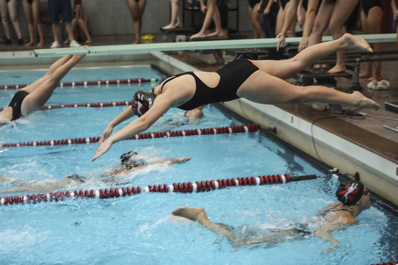 Girl diving into Naugatuck High School pool