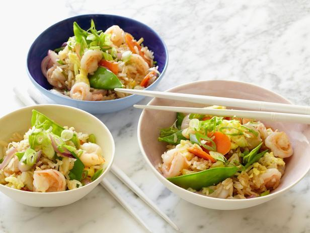 shrimp and rice in a bowl with chopsticks