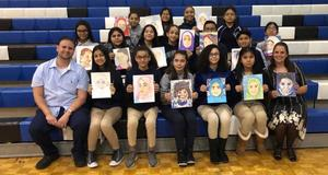 group photo of Ms. Wenz, Mr. Abbato, and the students who drew the portraits