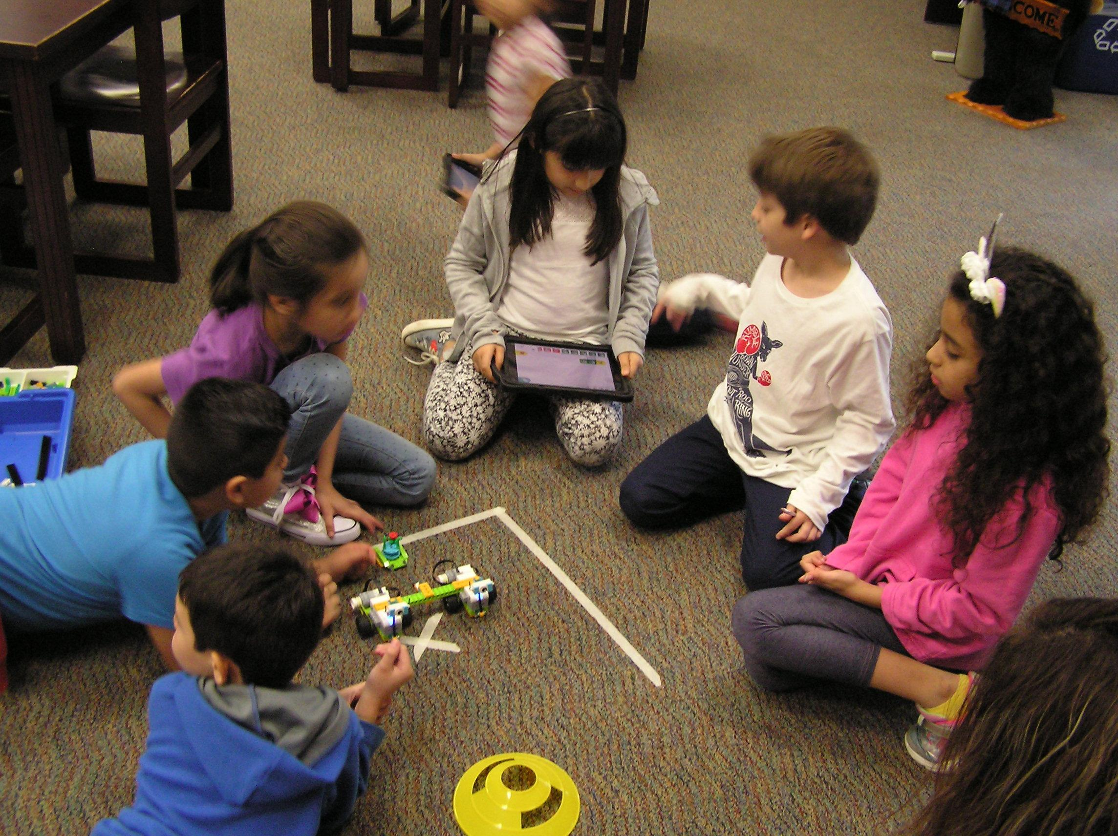 Students learning to construct a robot which they can code.