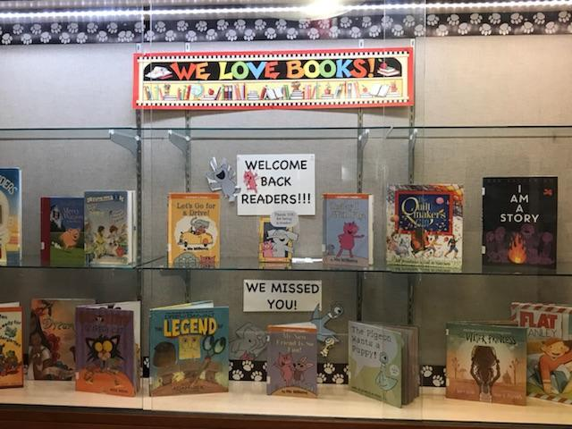 lovely book display of suggested titles for this month