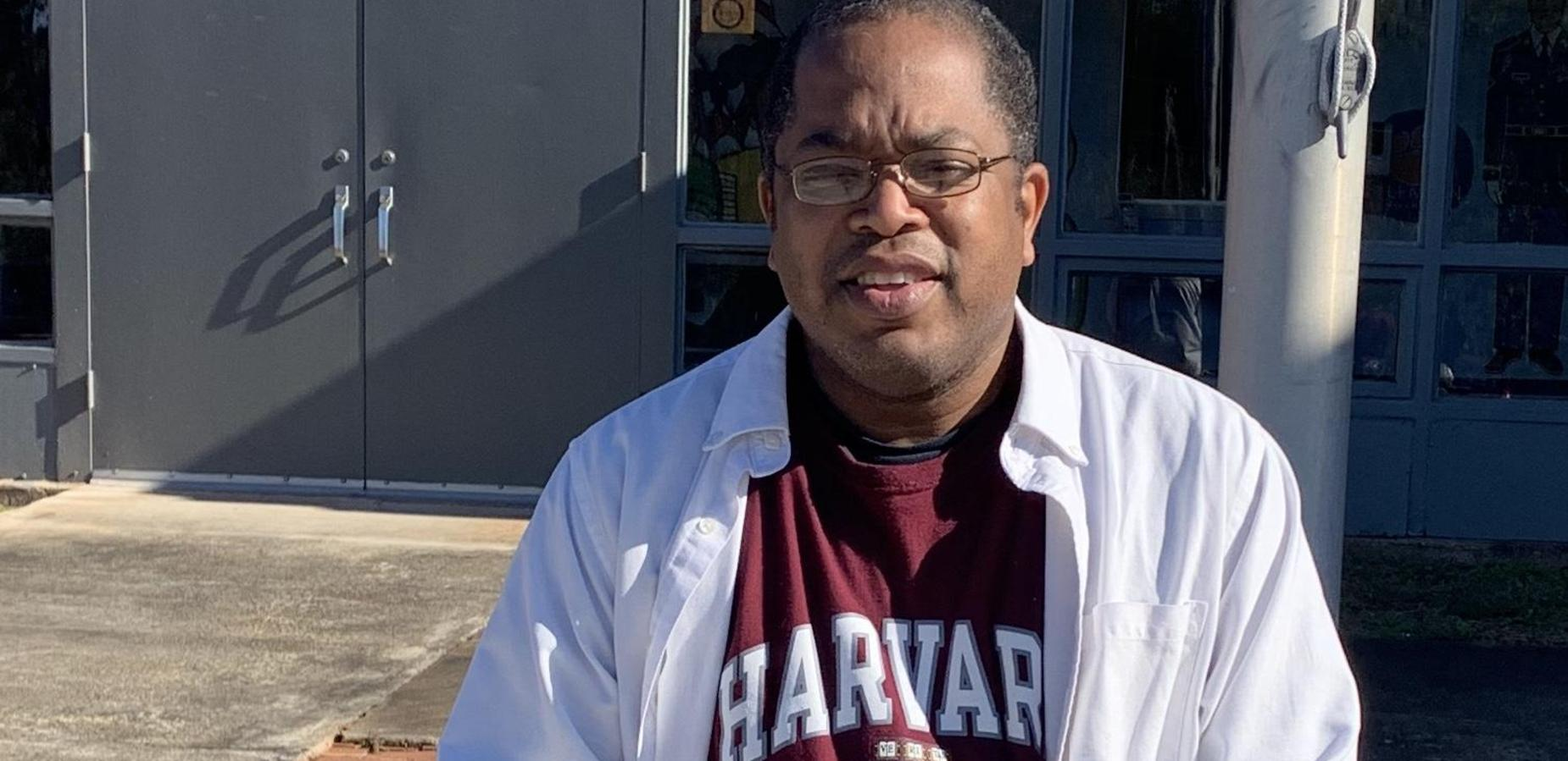 Mr. Holmes in Harvard college gear