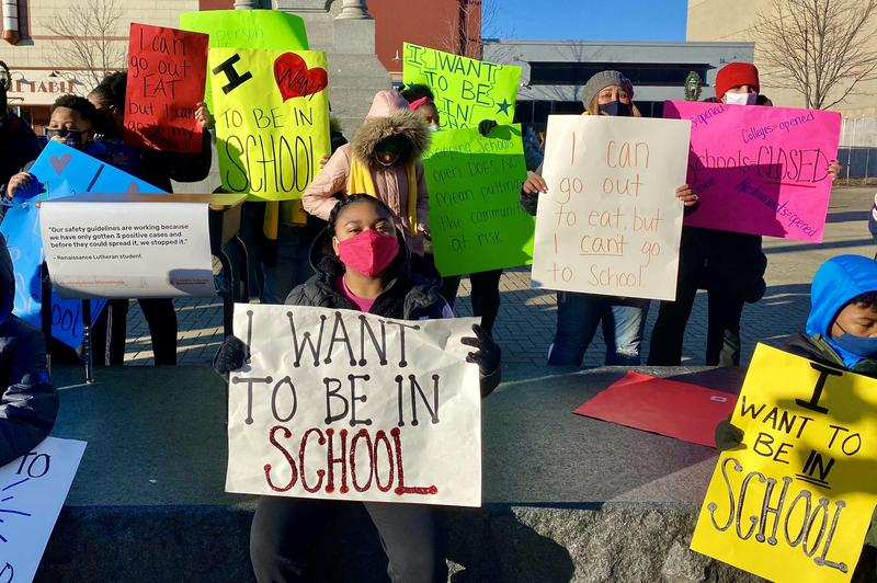 Parents, students and staff gather for protest at Monument Square in Racine.