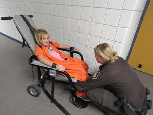 Isreal Sherk volunteers to be confined like a prisoner.