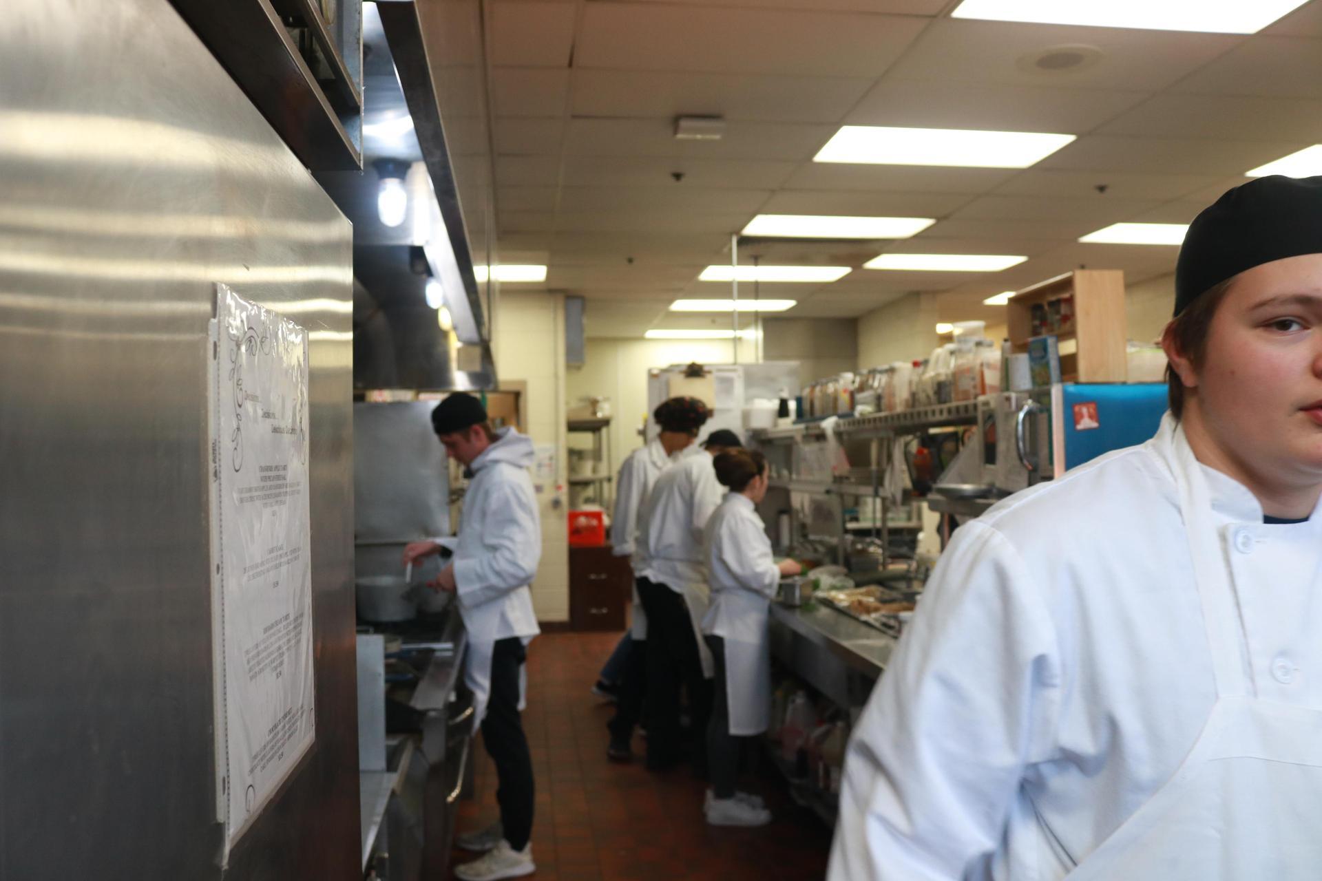 Students on kitchen line