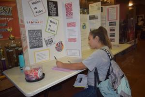 students next to table