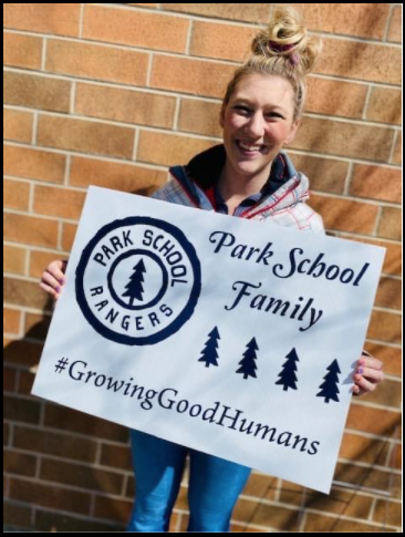 Brooke Hopkins Holding a Park Elementary Sign