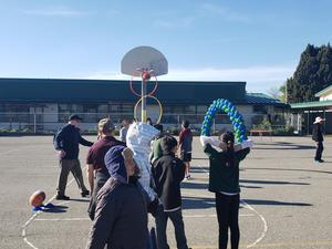Students participate in the basketball toss