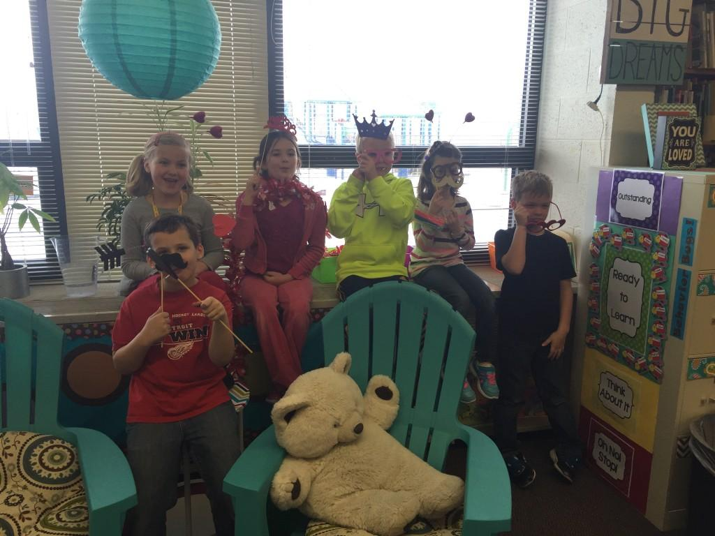 kids pose with mustache props