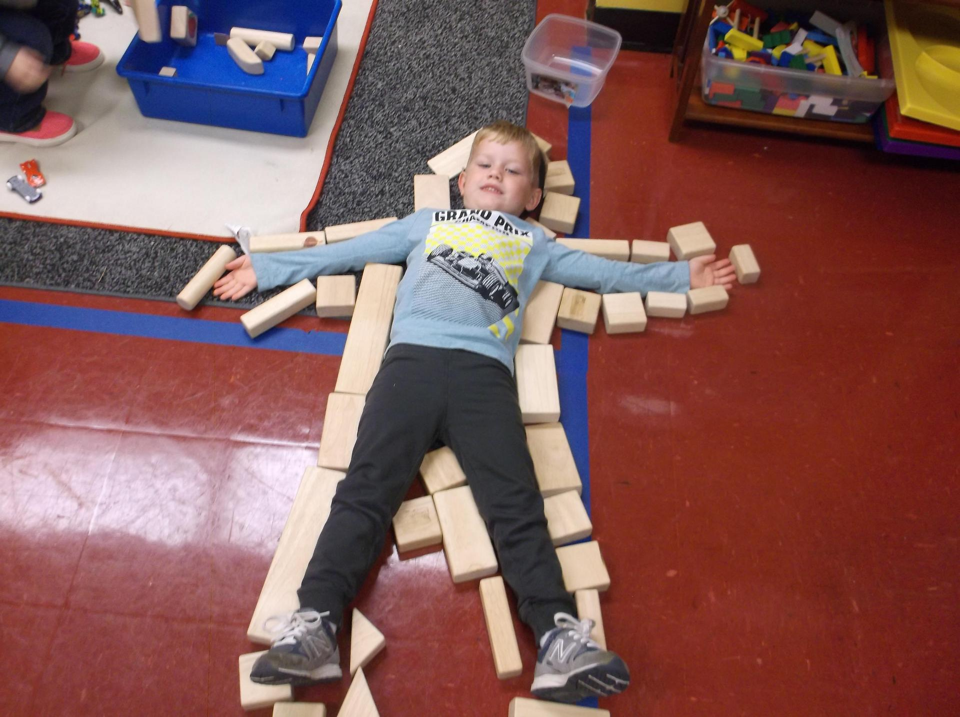 WTSD Preschool male child with blocks outlining body