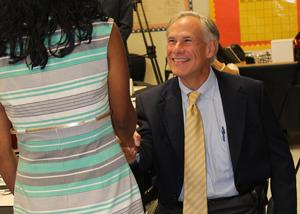 governor abbott shaking teachers hand