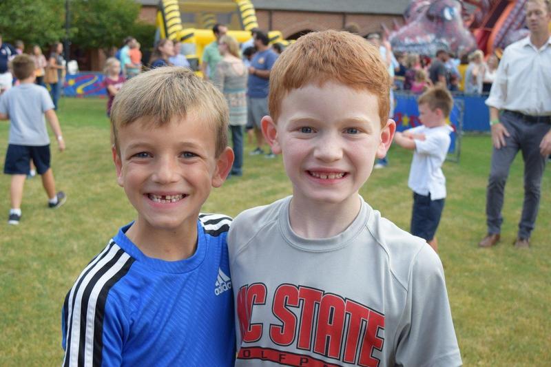 Two boys enjoying the Fall Festival