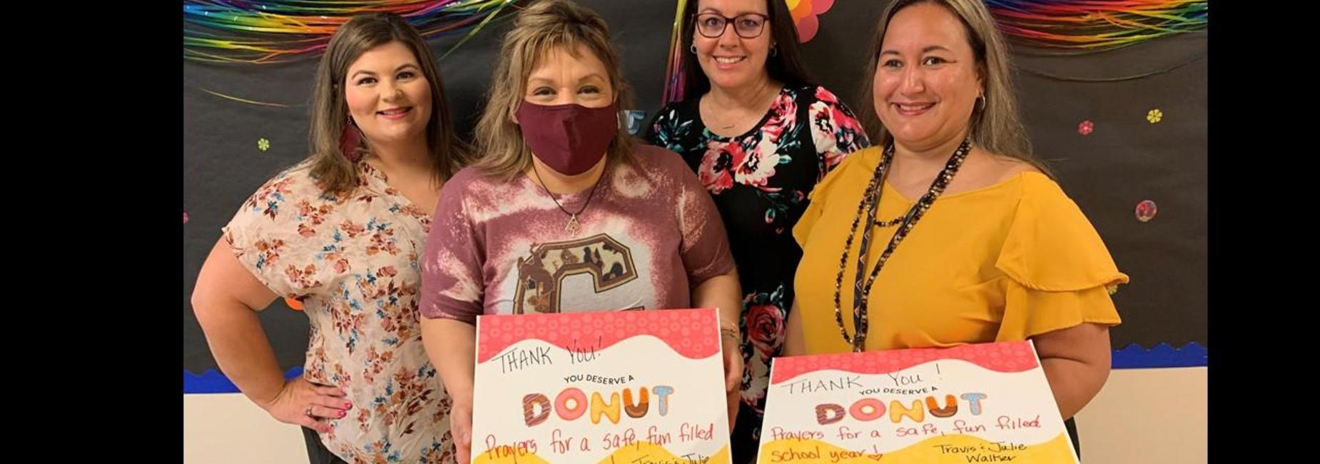 Teachers with donated donuts