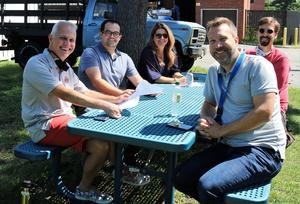 Photo of WHS visual and performing arts staff meeting outdoors for professional development session on Sept 2
