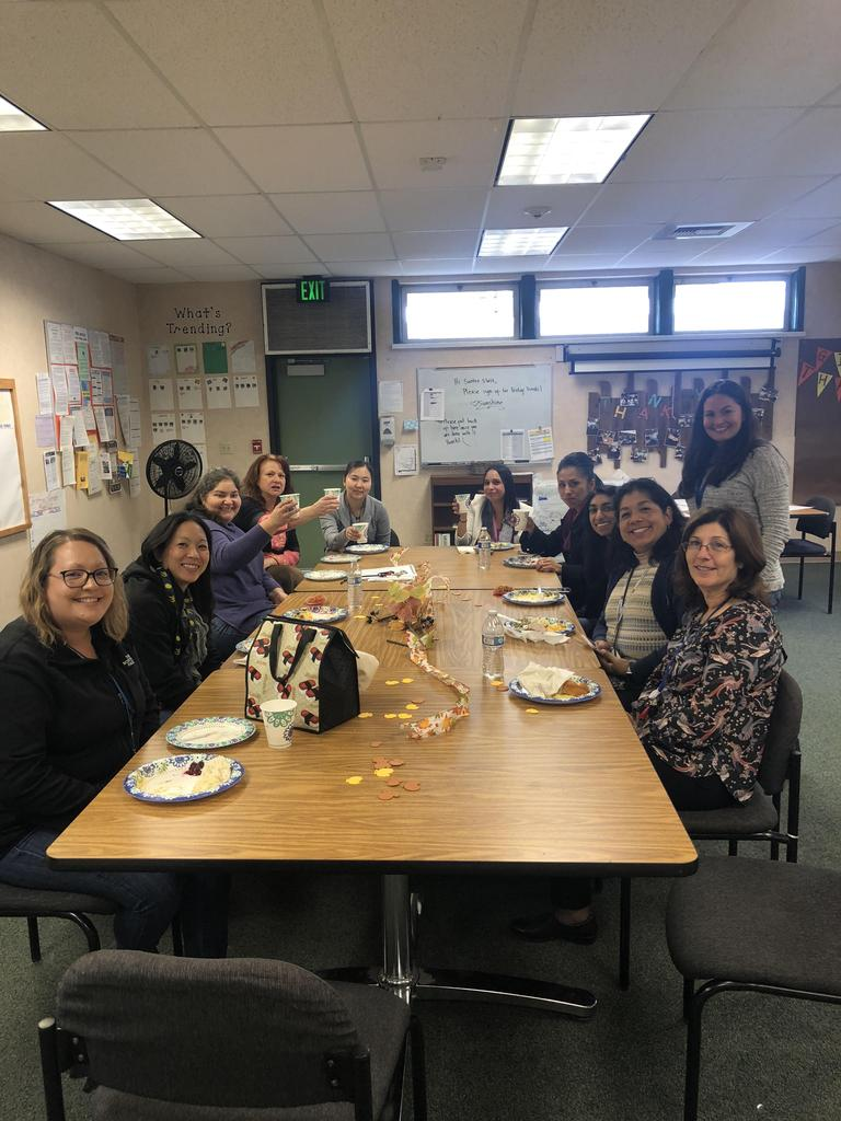 Santee staff sits and enjoys Thanksgiving potluck lunch