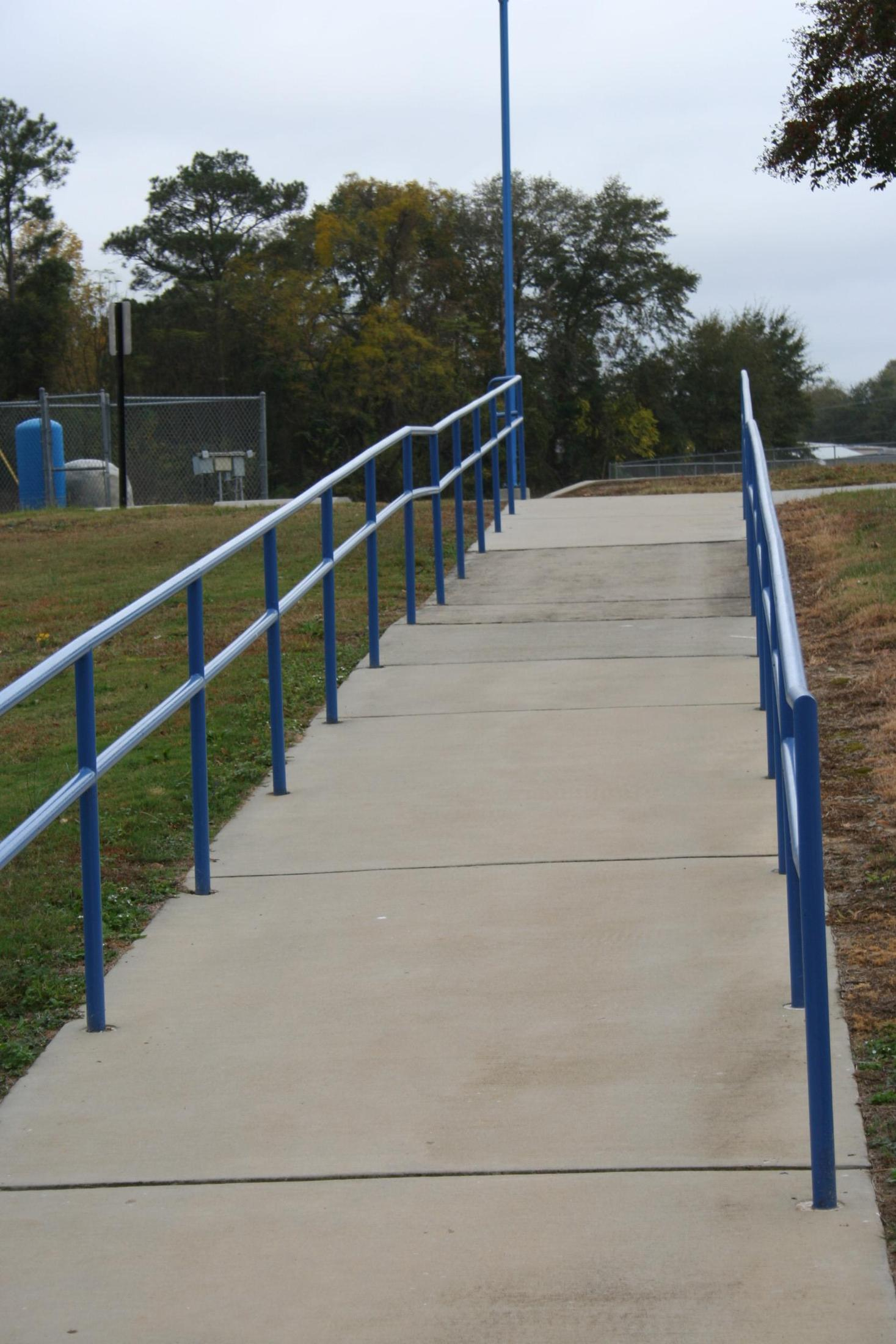 ADA ACCESSIBLE RAMP TO SOFTBALL SEATING AREA