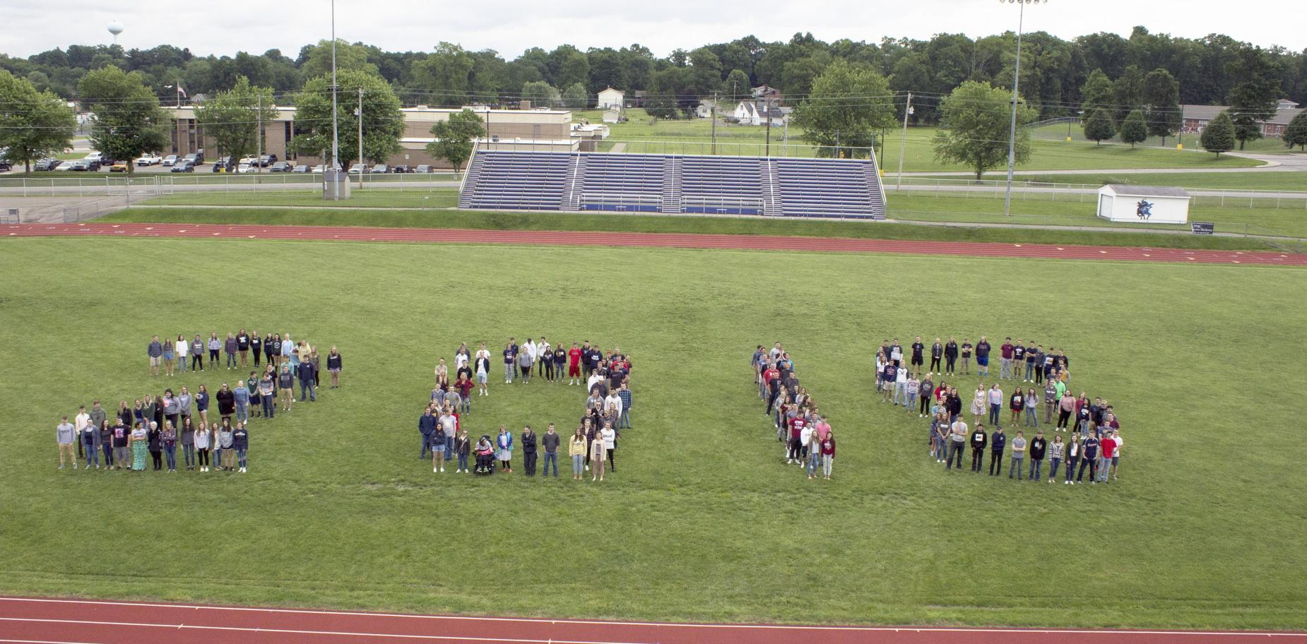 Class of 2018 on athletic field