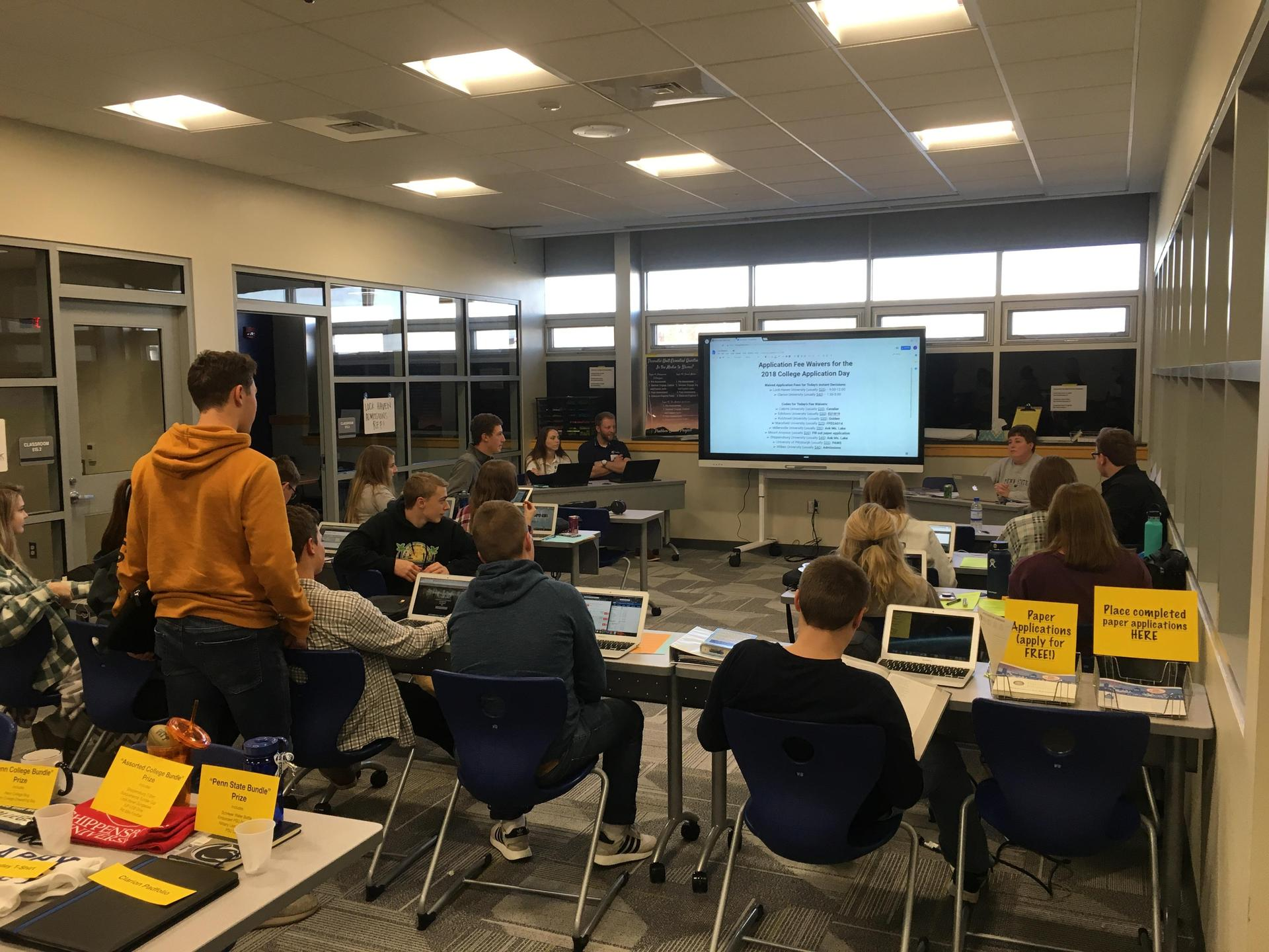 students working on college applications