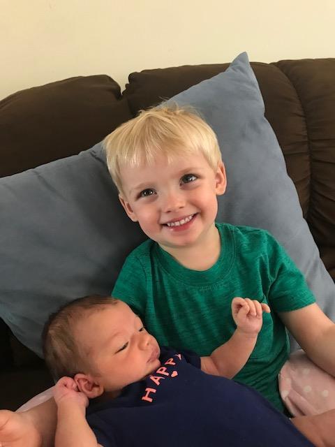Wyatt holding his baby sister.
